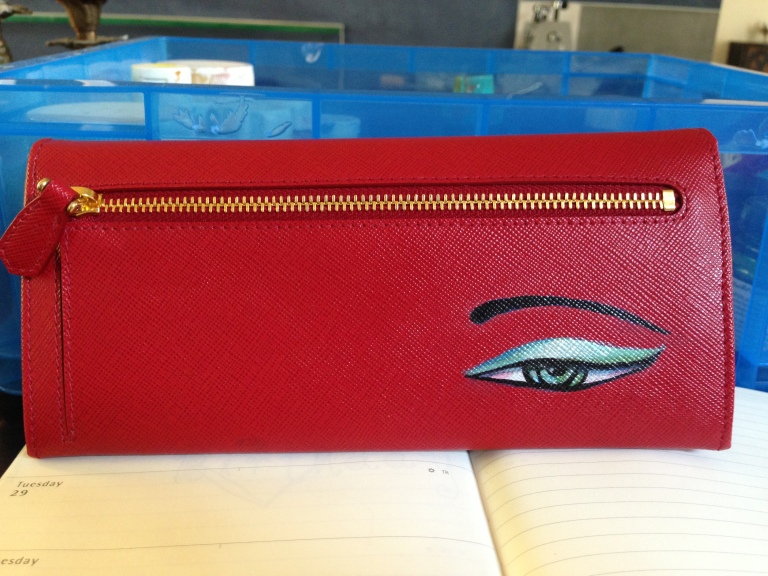 eye on prada wallet